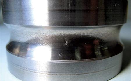 写真9-4 - 3.5.2 異物による圧こん